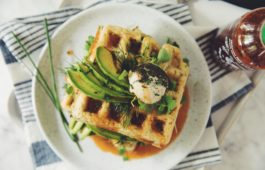 green waffles with spinach, avocado and sriracha maple syrup